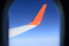 Airplane wing in blue sky Stock Photo