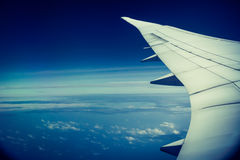 Airplane wing and blue sky outside the window | Beautiful high view aerospace Stock Photography