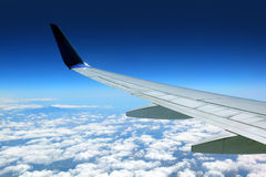 Airplane wing with blue sky Stock Photo