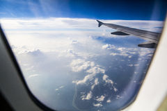 Airplane wing through cabin window Royalty Free Stock Images