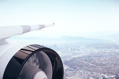 Airplane wing on city background. Airplane wing and turbine on city background. Travel concept. 3D Rendering Royalty Free Stock Photo