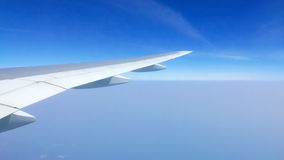 Airplane wing and clean blue sky Stock Photography