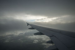 Airplane wing cloud sky Stock Images