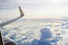 Airplane. Wing cloud sky wide travel Stock Images