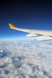 Airplane Wing + Clouded Globe Stock Photography