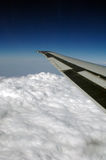 Airplane Wing and Clouds Stock Images