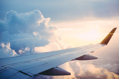 Airplane wing in clouds Stock Photography