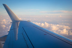 Airplane wing and clouds Royalty Free Stock Image
