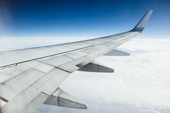 Airplane wing, clouds and blue sky Stock Photo