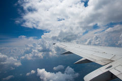 Airplane wing and clouds Royalty Free Stock Images