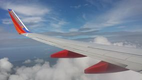 Airplane wing with Clouds under blue sky Royalty Free Stock Photography