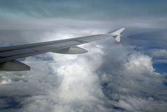 Airplane wing with cumulonimbus Stock Images