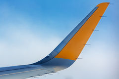Airplane wing detail on blue sky background aerial Royalty Free Stock Photo