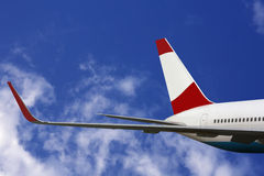 Airplane wing in flight. Wing at cruising altitude over clouds royalty free stock photos