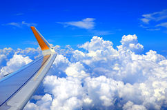Airplane wing. An airplane wing during flight above the sky royalty free stock photos