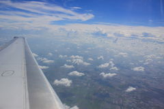 Airplane wing in flight on beautiful sky Stock Image