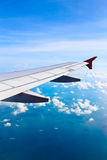Airplane wing. In flight with blue sky Stock Photos
