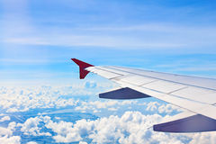 Airplane wing. In flight with blue sky royalty free stock photos