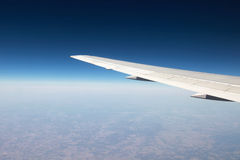 Airplane wing during a flight Royalty Free Stock Photography