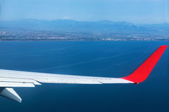 Airplane Wing in Flight from window Royalty Free Stock Photography