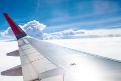 Airplane wing fly on blue sky | Trip travel business | Transportation commercial Stock Images