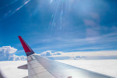 Airplane wing fly on blue sky | Trip travel business | Transportation commercial Royalty Free Stock Photos