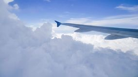 Airplane wing of flying aircraft moving on beautiful cloudy and sky. stock video