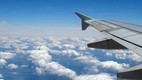 Airplane wing flying cloudy sky stock footage