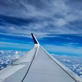 Delta Airplane flying high above the beautiful blue sky stock images
