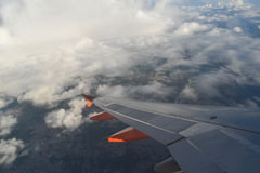 Airplane Wing. While flying over the clouds royalty free stock images