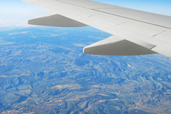 Airplane wing and landscape Stock Image