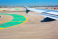 Airplane wing leaving the airport Royalty Free Stock Image