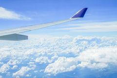 Airplane wing look from cabin window have cloud and land in below Stock Photos