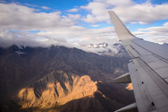 Airplane wing mountain Stock Photography