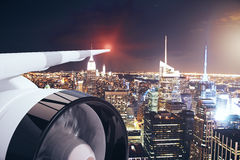 Airplane wing in night city. Airplane wing and turbine on night city background. Travel concept. 3D Rendering Royalty Free Stock Image