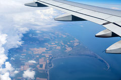 Airplane wing out of window Stock Images