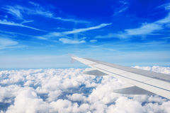Airplane wing out of window Royalty Free Stock Photos