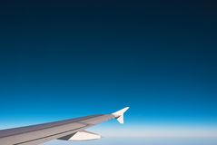 Airplane wing out of window Stock Photos