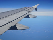 Airplane wing. Airplane wing over the Amazon jungle at dawn Royalty Free Stock Photo