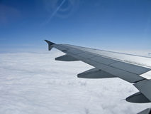 Airplane wing over the clouds, Stock Images