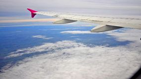 Airplane wing over Europe stock footage
