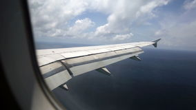 Airplane wing over Indian Ocean stock video