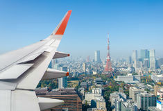 Airplane wing over Tokyo tower Royalty Free Stock Images