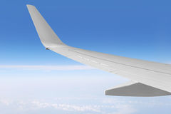 Airplane wing and sky Stock Photos