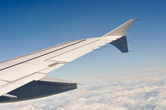 Airplane Wing in the Sky above Clouds Stock Photography