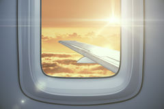 Airplane wing on sky background Stock Photo