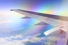 Airplane wing in the sky Stock Photography