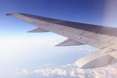Airplane wing in the sky Royalty Free Stock Photos