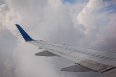 Airplane wing sky clouds Stock Photography