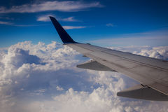 Airplane wing sky clouds Royalty Free Stock Image
